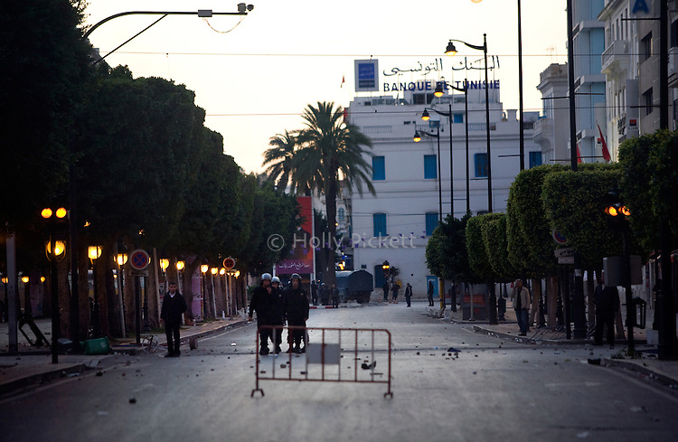 As night falls, police maintain control of downtown Tunis, following a demonstration at the Interior Ministry Interior Ministry in Tunis, Tunisia, Jan. 14, 2011.