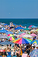 Crowded summer beach with colorful umbrellas, Nauset Beach, Cape Cod National Seashore, Cape Cod, MA, Massachusetts, USA