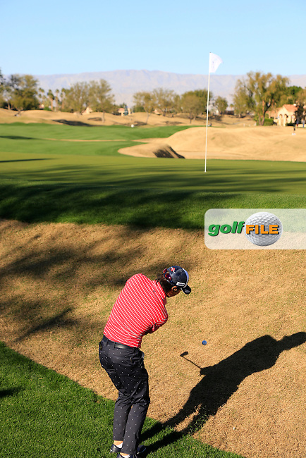 Ryo Ishikawa (JPN) chips onto the 16th green during Saturday's Round 3 of the 2017 CareerBuilder Challenge held at PGA West, La Quinta, Palm Springs, California, USA.<br /> 21st January 2017.<br /> Picture: Eoin Clarke   Golffile<br /> <br /> <br /> All photos usage must carry mandatory copyright credit (&copy; Golffile   Eoin Clarke)