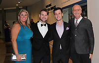 NWA Democrat-Gazette/CARIN SCHOPPMEYER Mandy Macke (from left), Tristin Dalton and Austin Walker and Johnny Mike Walker help support Circle of Life Hospice at Art of Hospice on Nov. 2 at Crystal Bridges Museum of American Art in Bentonville.