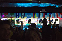 New York, NY - Saturday, June 14, 2014: Colombia fans cheer on their team during the Colombia vs. Greece first round World Cup match at a billiards halls in the Jackson Heights neighborhood of Queens, New York.