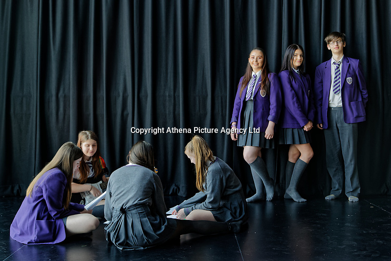 Pictured standing L-R: Year 10 pupils Tamzin Samuels, Jenna Roderick and James Lockey rehearse Wales National Opera's Rhondda Rips It UP at of John Frost School in Newport, Wales, UK. Thursday 11 May 2018<br /> Re: Welsh National Opera is creating a new musical hall-style all female piece for the summer called Rhondda Rips It Up. It's about the life of suffragette Lady Rhondda with songs inspired by suffragette slogans. Opera opening next month in Newport, south Wales, where Lady Rhondda blew up a postbox with a home-made bomb and went to jail for.