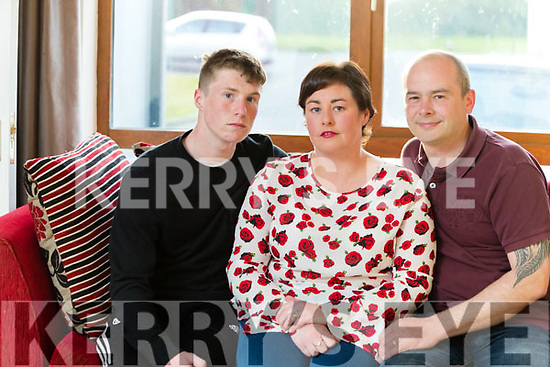 Noelle Robb who lost three children because of blood condition. She is warning other families to get tested, Pictured with her husband Andrew and son Andrew.