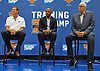 Jeff Hornacek, New York Knicks Head Coach, left, sits alongside General Manager Steve Mills and President Phil Jackson during a news conference at MSG Training Center in Greenburgh on Friday, Sept. 23, 2016.