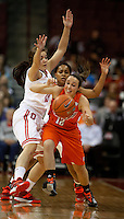 Bowling Green Falcons guard Rachel Konieczki (12) gets pressured by Ohio State Buckeyes guard Cait Craft (13) and Ohio State Buckeyes guard Maleeka Kynard (12) in the first half at Value City Arena in Columbus Nov. 24, 2013.