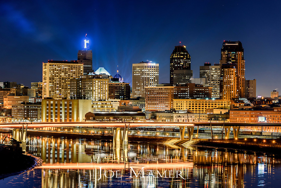 Saint Paul, Minnesota skyline at dusk from Mounds Park with searchlights from the Red Bull Crashed Ice event.