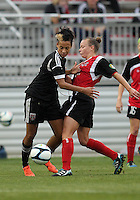 BOYDS, MARYLAND - July 21, 2012:  Lianne Sanderson (10) of DC United Women clashes with Jamie Clark (23) of the Virginia Beach Piranhas during a W League Eastern Conference Championship semi final match at Maryland Soccerplex, in Boyds, Maryland on July 21. DC United Women won 3-0.