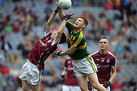 Kerry's Brian Friel and Galway's Liam Boyle jump for the ball  in the All-Ireland Minor final at Croke on Sunday.<br /> Photo: Don MacMonagle