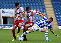 Stevenage's Jonathan Smith and Danny Newton battles with Colchester United's Ben Dickenson<br /> <br /> Photographer Hannah Fountain/CameraSport<br /> <br /> The EFL Sky Bet League Two - Colchester United v Stevenage Borough - Saturday August 12th 2017 - Colchester Community Stadium - Colchester<br /> <br /> World Copyright &copy; 2017 CameraSport. All rights reserved. 43 Linden Ave. Countesthorpe. Leicester. England. LE8 5PG - Tel: +44 (0) 116 277 4147 - admin@camerasport.com - www.camerasport.com
