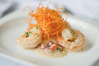 Shrimp and Sliced Decorative Carrots in a Garlic Cream Sauce filled with Tomatoes and other mixed spices