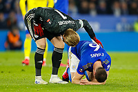 4th March 2020; King Power Stadium, Leicester, Midlands, England; English FA Cup Football, Leicester City versus Birmingham City; Kasper Schmeichel of Leicester City checks on an injured Jonny Evans