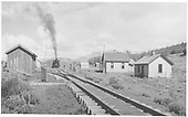 Train taking a breather after 15-mile run up the 4% grade.<br /> RGS  Dallas Divide (Peake), CO  Taken by Best, Gerald M. - 7/16/1941
