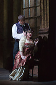 London, UK. 1 October 2016. Keri Alkema as Tosca and Craig Colclough as Scarpia.  Dress rehearsal of the Giacomo Pucccini opera Tosca with Keri Alkema as Floria Tosca, Gwyn Hughes Jones as Mario Cavaradossi and Craig Colclough as Baron Scarpia. Donna Stirrup is the revival director of Catherine Malfitano's original ENO production of Tosca, set design by Frank Philipp Schlössman. 13 performances at the London Coliseum from 3 October to 3 December 2016.