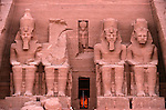 Fascade of Temple, Abu Simbel, Egypt, Colossal figures of Ramses II wearing double crown, New Kingdom.