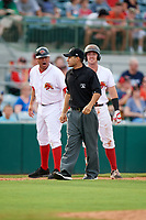 Florida Fire Frogs coach Tomas Perez (9) argues with umpire Jose Navas during a game against the St. Lucie Mets on July 23, 2017 at Osceola County Stadium in Kissimmee, Florida.  St. Lucie defeated Florida 3-2.  (Mike Janes/Four Seam Images)