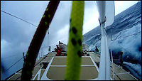 BNPS.co.uk (01202 558833)<br /> Pic: ClipperRace/BNPS <br /> <br /> ***Please Use Full Byline***<br /> <br /> The 'calm' before the storm, crewmen on the Great Britain sail the boat. <br /> <br /> This is the heart-stopping moment two British sailors are washed off the side of a yacht as it is knocked flat by a tornado in the middle of the ocean.<br /> Sarah Usher and Liz Richards are seen desperately trying to grab hold of the 70ft boat as they are swept overboard when the freak weather conditions hit.<br /> Their 70ft yacht was blown onto one side as the wind built then smashed almost 180 degrees onto the other as the tornado struck.<br /> Winds of more than 115mph pinned the capsized yacht down for around 60 seconds.<br /> Dramatic footage of the ordeal shows the boat's crew dragging the pair out of the water and back on board the boat as the winds ease.<br /> The tornado can then be seen disappearing into the distance as the boat returns to upright.<br /> Sarah, 34, from Hull, East Yorks, and Liz, 65, from Dartmouth, Devon, were both wearing life jackets at the time and were shaken but uninjured in the ordeal.<br /> They were part of an 18-strong crew on the Great Britain yacht competing in the Clipper Round the World Race, a 40,000-mile yacht race for amateur sailors.