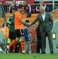 Robin Van Persie of Holland shakes hands with manager Bert Van Marwijk after being substituted