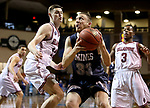 SIOUX FALLS, SD: MARCH 22: Murphy Gershman #33 from Colorado Mines eyes the basket against Alex Cook #11 from Bellarmine during the Men's Division II Basketball Championship Tournament on March 22, 2017 at the Sanford Pentagon in Sioux Falls, SD. (Photo by Dave Eggen/Inertia)