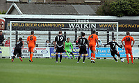 Pictured: Chris Jones of Neath (7) opening the score with a penalty shot, Thorsten Stuckman goalkeeper for Swansea (in green) fails to save the ball. Saturday 17 July 2011<br />