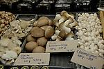 Selection of mushrooms on market stall in vegetable market. Viktualienmarkt, Munich, Germany.