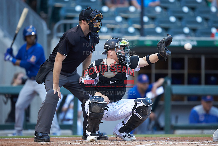 Charlotte Knights catcher Zack Collins (8) reaches for a pitch as home plate umpire Brian Peterson looks on during the game against the Durham Bulls at BB&T BallPark on July 31, 2019 in Charlotte, North Carolina. The Knights defeated the Bulls 9-6. (Brian Westerholt/Four Seam Images)