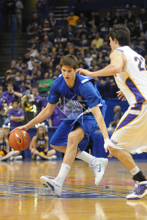 March 4,  2011             Creighton Bluejays forward Doug McDermott (3) dribbles the ball downcourt as he's blocked by Northern Iowa Panthers guard Kerwin Dunham (22) late in the game. Creighton defeated Northern Iowa 60-57 in the second quarterfinal game of the NCAA Missouri Valley Conference Men's Basketball Tournament on Friday March 4, 2011 at the Scottrade Center in downtown St. Louis.