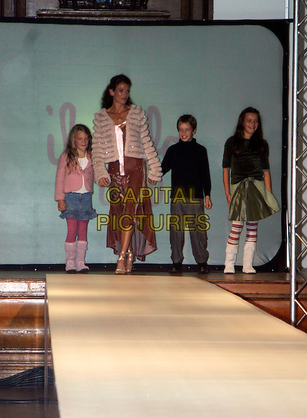 ANNABEL CROFT & KIDS.SPARKS Fashion Show, Porchester Hall, London..October 6th, 2005.full length holding hands child catwalk .www.capitalpictures.com.sales@capitalpictures.com.© Capital Pictures.
