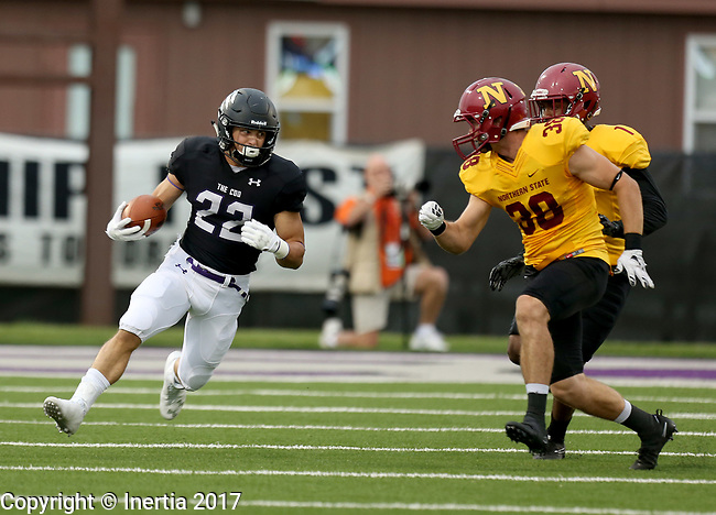 SIOUX FALLS, SD - SEPTEMBER 8: Max Mickey #22 from the University of Sioux Falls looks for running room past Brian Sumption #38 and Etienne Ezeff #1 from Northern State in the first half of their game Saturday night at Bob Young Field in Sioux Falls. (Photo by Dave Eggen/Inertia)