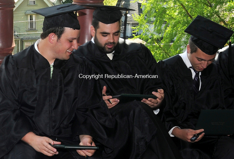 WATERBURY, CT-06 MAY 2010-050610IP02- (l to r)  Eli Greenfield, Craig Linda and Yisroel Chafetz, students at Yeshiva Ateres Shmuel in Waterbury, look at their diplomas during the commencement ceremony at the school on Thursday. Students earned degrees from Post University through Yeshiva's participation in the Post University Partners in Education program. Yeshiva students received a 10 percent tuition grant toward their undergraduate degrees at Post University.                                                                                                                                                                                                                                                                                                                                                                                                                                                                                                                                                                                                                                                                                                                                                                                                                                                                                                                                                                                                                                                                                                                                                                                                                                                                                                                                                                                                                                                                                                                                                             <br /> Irena Pastorello Republican-Amer
