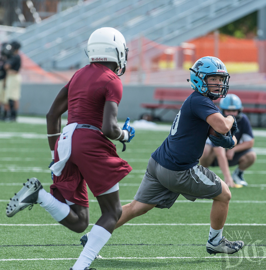 NWA Democrat-Gazette/ANTHONY REYES &bull; @NWATONYR<br /> Springdale against Springdale Har-Ber Friday, July 10, 2015 during the Southwest Elite 7 on 7 tournament at Jarrell Williams Bulldog Stadium in Springdale.