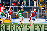Thomas Moriarty gets in his shot against Conor Jenkins Rathmore during the O'Donoghue Cup final in Fitzgerald Stadium on Sunday