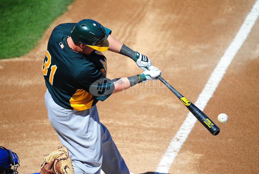 Mar. 15, 2012; Surprise, AZ, USA; Oakland Athletics batter Jonny Gomes bats in the first inning against the Texas Rangers at Surprise Stadium.  Mandatory Credit: Mark J. Rebilas-