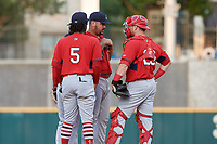 Springfield Cardinals pitcher Williams Perez (21) talks with catcher Jose Godoy (27) and third baseman Alberto Triunfel (5) during a Texas League game against the Frisco RoughRiders on May 6, 2019 at Dr Pepper Ballpark in Frisco, Texas.  (Mike Augustin/Four Seam Images)