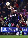 Diego Godin vies with Pajtim Kasami during the UEFA Champions League semifinal first leg football match Club Atletico de Madrid vs Olympiacos at the Vicente Calderon stadium in Madrid on November 26, 2014.   PHOTOCALL3000/ DP