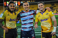 Fomer Hurricane Tamati Ellison (centre) with Ma'a Nonu (left) and Cory jane the Super Rugby match between the Hurricanes and Rebels at Westpac Stadium, Wellington, New Zealand on Friday, 13 March 2015. Photo: Dave Lintott / lintottphoto.co.nz