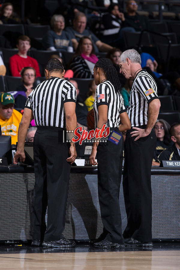 (L-R) Officials Billy Smith, Angelica Suffren, and Bruce Morris huddle up to review a play on video during the ACC women's basketball game between the Louisville Cardinals and the Wake Forest Demon Deacons at the LJVM Coliseum on January 11, 2015 in Winston-Salem, North Carolina.  The Cardinals defeated the Demon Deacons 79-68.  (Brian Westerholt/Sports On Film)