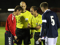 Team Captains Gor Malakyan and Marcus Fraser with match referee Oliver Drachta in the Scotland v Armenia UEFA European Under-19 Championship Qualifying Round match at New Douglas Park, Hamilton on 9.10.12.