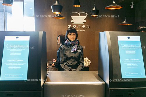 (L to R) A woman and an humanoid robot debuted working at the front desk of Henn-na (Weird) Hotel Ginza on January 26, 2018, Tokyo, Japan. The new branch of Henn-na (Weird) Hotel is managed by humans and robots, some of which are programmed to attend guests in English, Chinese Korean and Japanese languages. The hotel has 10 floors and 98 rooms, with rates starting from JPY7000 per night. Every room has a LG Styler Steam Clothing Care and a smartphone to manage utilities including lights, air conditioner and TV through an app. The fifth branch will open to the public from February 1st. (Photo by Rodrigo Reyes Marin/AFLO)