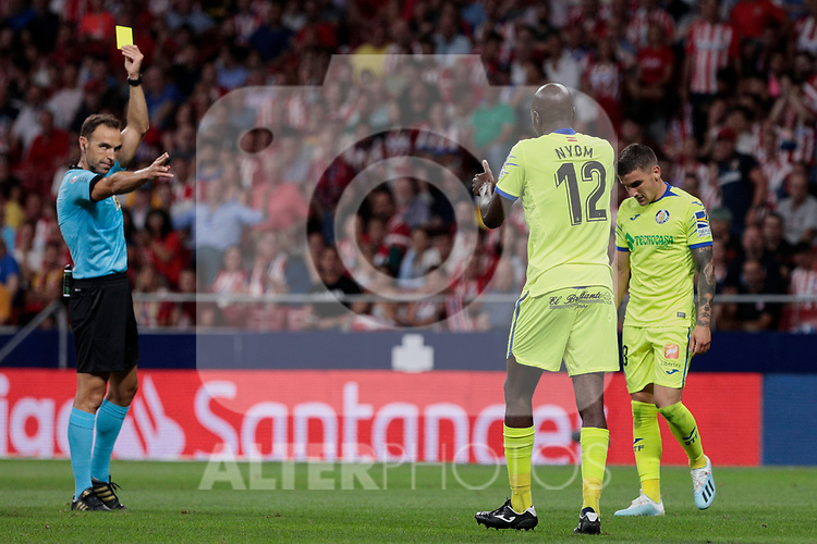 Getafe CF's Allan-Romeo Nyom see the yellow card during La Liga match between Atletico de Madrid and Getafe CF at Wanda Metropolitano Stadium in Madrid, Spain. August 18, 2019. (ALTERPHOTOS/A. Perez Meca)