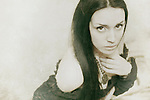 atmospheric and ghostly photo of beautiful young caucasian woman in retro style