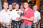 Stephen O'Neill, winner of the Murphy Cup darts final in Murphys Bar, Killarney, pictured as he received the cup from Sean Murphy on Tuesday night. Also pictured are Matt Lacey, finalist, Denis Brosnan, Roland Sauter and Dermot Kelliher...