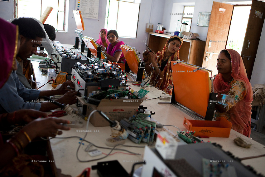 Indian students solder and assemble circuit boards in class in the Barefoot College in Tilonia village, Ajmer, Rajasthan, India. Photo by Suzanne Lee for Panos London