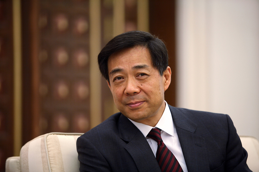 Chinese Commerce Minister Bo Xilai in a meeting in his Beijing office May 17, 2006. Born in July 1949, Bo Xilai began working in a Beijing factory in January 1968 and joined the Communist Party of China (CPC) in October 1980.