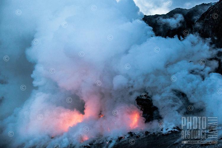 Lava flows into the ocean at dawn in Kalapana, Big Island.