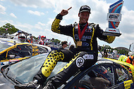 Washington, DC - June 22, 2014: Patrik Sandell holds the first place trophy as he sits atop the #18 Olsbergs MSE Ford Fiesta after winning the 3rd Round of the Red Bull Global Rallycross on the grounds of RFK Stadium in the District of Columbia, June 22, 2014.   (Photo by Don Baxter/Media Images International)