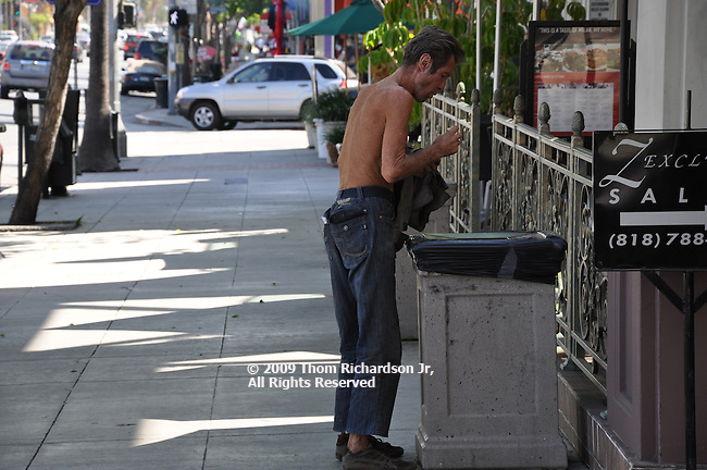 Man eating from trash can Homeless Man, Sherman Oaks California