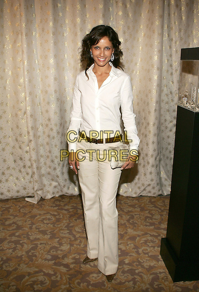 LEONOR VARELA.5th Annual Awards Season Diamond Fashion Show Preview, hosted by the Diamond Information Center and Instyle Magazine at the Beverly Hills Hotel, Beverly Hills, California. .January 12th, 2006.Photo: William Scott/AdMedia/Capital Pictures.Ref: WS/ADM.full length beige white top trousers clutch purse.www.capitalpictures.com.sales@capitalpictures.com.© Capital Pictures.