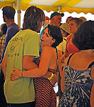 Members of the audience dancing to the music of the Steve Riley & The Mamou Playboys band, on the Dance Stage of the 2012 Clearwater Festival at Croton Point Park on Sunday, June 17, 2012. Photograph taken by Jim Peppler. Copyright Jim Peppler/2012