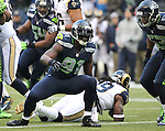 Seattle Seahawks defensive end Chris Clemons celebrates a tackle against St. Louis Rams running back Steven Jackson, at CenturyLink Field in Seattle, Washington on  December 30, 2012.  © 2102.  Jim Bryant Photo. All Rights Reserved.