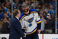 June 12, 2019: St. Louis Blues defenseman Alex Pietrangelo (27) shakes hands with National Hockey League Commissioner Gary Bettman during game 7 of the NHL Stanley Cup Finals between the St Louis Blues and the Boston Bruins held at TD Garden, in Boston, Mass. The Saint Louis Blues defeat the Boston Bruins 4-1 in game 7 to win the 2019 Stanley Cup Championship.  Eric Canha/CSM